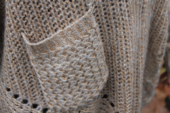 detail pull doré